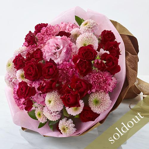 バラとカーネーションの花束の画像