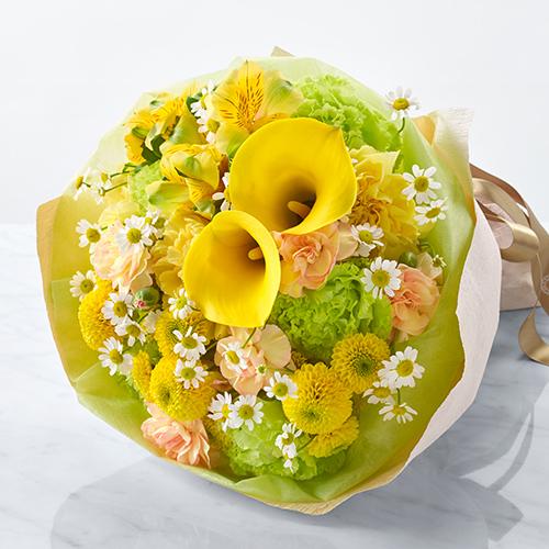 黄色いカラーマムの花束の画像